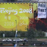 Activists unfurl a Free Tibet banner next to China Central Television HQ